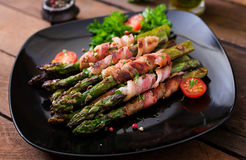 Grilled  asparagus wrapped with bacon. Royalty Free Stock Photo
