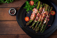Grilled  asparagus wrapped with bacon Stock Images