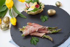 Grilled asparagus wrapped in prosciutto. stock image