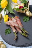 Grilled asparagus wrapped in prosciutto. royalty free stock photos