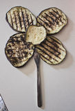 Grilled aubergine or a flower? Stock Images