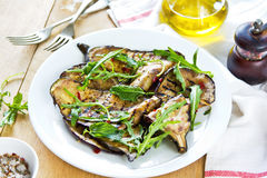 Grilled Aubergine salad with Rocket Stock Image