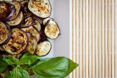 Grilled aubergines with basil. Platter of grilled aubergines with basil. Plenty of copy space Royalty Free Stock Images