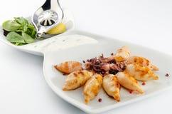 Grilled baby calamari Stock Image