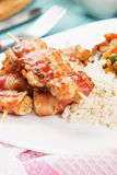 Grilled bacon and chicken skewer Royalty Free Stock Images