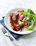 Grilled Bacon with Peppercorns and Salad Stock Photo