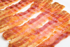 Grilled Bacon Rashers. Grilled streaky bacon rashers close up Stock Photo