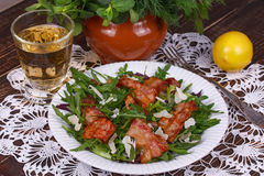 Grilled bacon with rucola salad and cheese; Royalty Free Stock Images