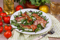 Grilled bacon with rucola salad and cheese; Royalty Free Stock Photos