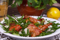 Grilled bacon with rucola salad and cheese Royalty Free Stock Images