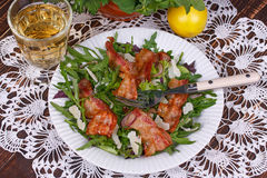 Grilled bacon with rucola salad and cheese Stock Image