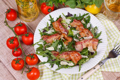 Grilled bacon with rucola salad and cheese Royalty Free Stock Photos