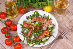 Grilled bacon with rucola salad and cheese Stock Photography