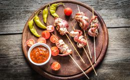 Grilled bacon skewers with chicken, peppers and cherry tomatoes Royalty Free Stock Image