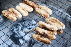 Grilled bananas on a steel mesh Royalty Free Stock Photography