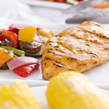 Grilled barbecue chicken closeup stock photo