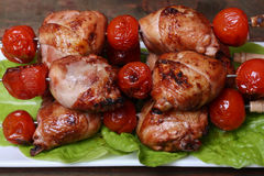 Grilled barbecue kebab chicken legs and tomatoes on skewers Stock Images