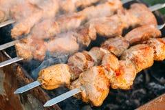 Grilled Barbecue Meat Shashlik Shish Kebab Pork Meat Grilling On MetalSkewer. Nobody. Grilled Marinated Caucasus Barbecue Meat Shashlik Shish Kebab Pork Meat Royalty Free Stock Photos