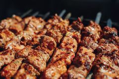 Grilled barbecue meat on skewers. Closeup view Royalty Free Stock Images