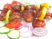 Grilled barbecue meat with vegetables Stock Images