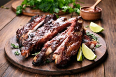 Grilled barbecue pork ribs on wooden board Royalty Free Stock Image
