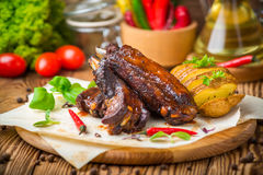 Grilled barbecue pork ribs. On wooden board Stock Image