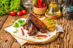 Grilled barbecue pork ribs. On wooden board Stock Photos