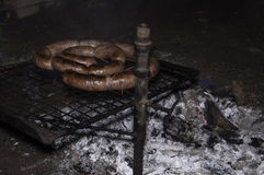 Grilled barbecue sausage. Autochthonous food from Latin America Royalty Free Stock Photos