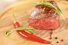 Grilled barbecue steak with spices. Royalty Free Stock Image