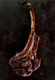 Grilled or barbecued tomahawk steak Stock Photos