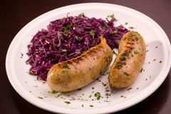 Grilled bavarian sausage with cauliflower Royalty Free Stock Images