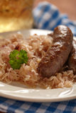 Grilled bavarian sausages with sauerkraut Stock Images