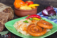 Grilled bavarian sausages with sauerkraut Stock Photography