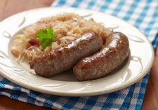 Grilled bavarian sausages with sauerkraut Royalty Free Stock Photography