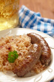 Grilled bavarian sausages with sauerkraut Royalty Free Stock Photos