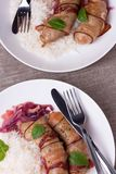 Grilled Bavarian Sausages With Rice And Mint On White Dish Royalty Free Stock Photography