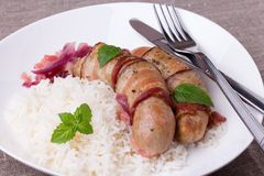 Grilled Bavarian Sausages With Rice And Mint On White Dish Royalty Free Stock Image