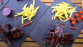 Grilled bbq ribs on stone plate stock video