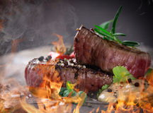 Grilled bbq steaks. With fire flames stock photography