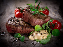 Grilled bbq steaks. With fresh herbs and tomatoes Stock Photos