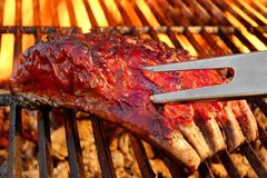 Grilled BBQ Tasty Smoked Marinated Pork Ribs At Summer Party Stock Photo