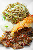 Grilled beaf with noodles above view Stock Photo