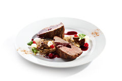 Grilled Beef. With Berries and Mushrooms stock image