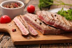 Grilled beef on board. And pepper Stock Images