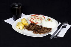 Grilled beef fillet assorted peruvian dish chili sauce, rice, potatoes, tomatoes Stock Photos