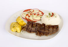 Grilled beef fillet assorted peruvian dish chili sauce, rice, potatoes, tomatoes Royalty Free Stock Image