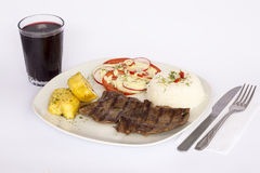 Grilled beef fillet assorted peruvian dish chili sauce, rice, potatoes, tomatoes Stock Photography