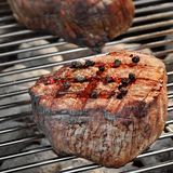 Grilled Beef Fillet Medallions On The Flaming Barbecue Grid Royalty Free Stock Photos