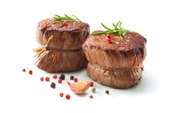 Grilled beef fillet steaks mignon  on white background. Grilled beef fillet steaks mignon with spices  on white background Stock Image