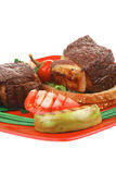 Grilled beef garnished with apples Royalty Free Stock Photo